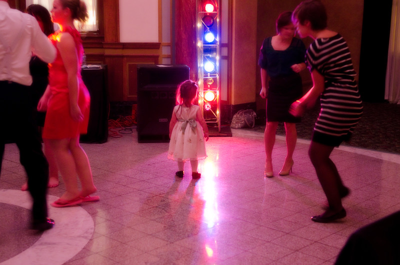 Girl admiring the dance floor lights at the Rotunda Waukesha during a wedding reception.