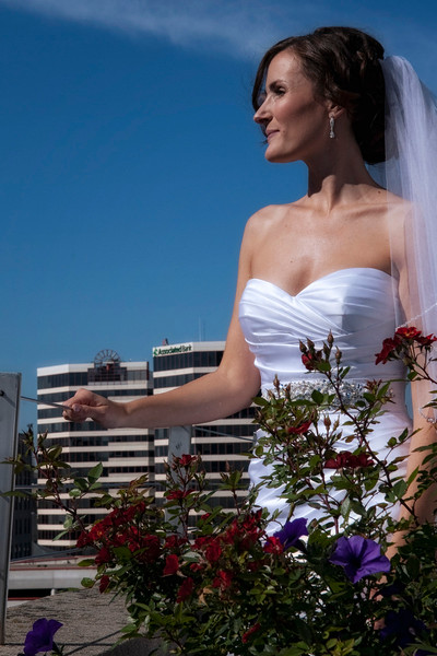 Wedding photo of Milwaukee bride overlooking rooftop at Hotel Metro Milwaukee.