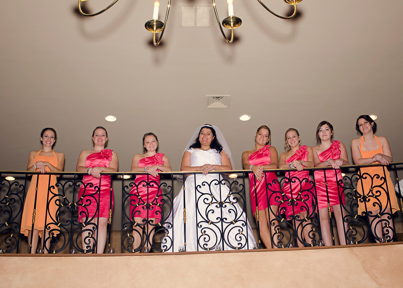 Bride and bridesmaids along the balcony of the Rotunda in Waukesha.