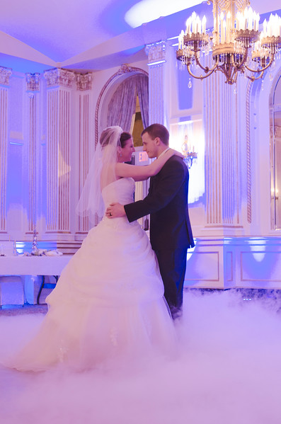 First dance wedding photo under the historic lights of the Astor Hotel Milwaukee.