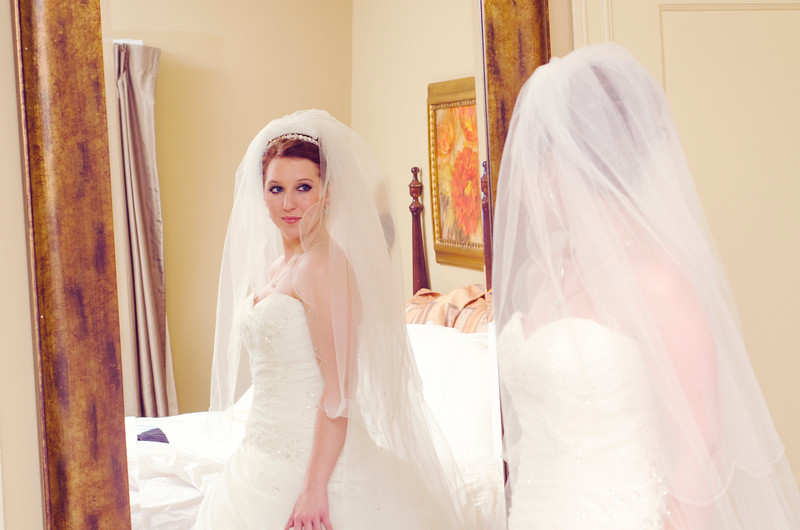 Bride's reflection in mirror at the Astor Hotel Milwaukee.