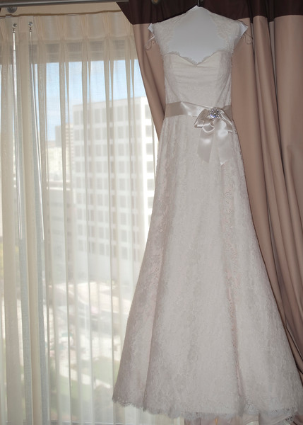 Wedding dress inside Intercontinental Milwaukee hotel room.