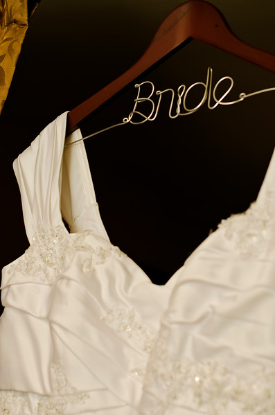 "Wedding dress on ""bride"" hanger."
