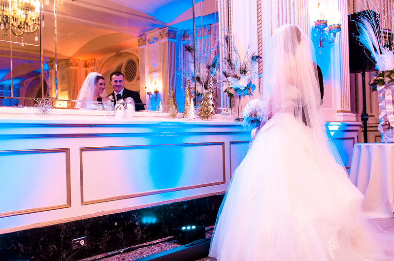 Bride and groom wedding photo of their reflection as a married couple at the Astor Hotel Milwaukee.