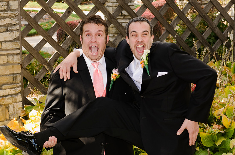 Fun photo of groom and groomsman in the gardens of Frame Park Waukesha.