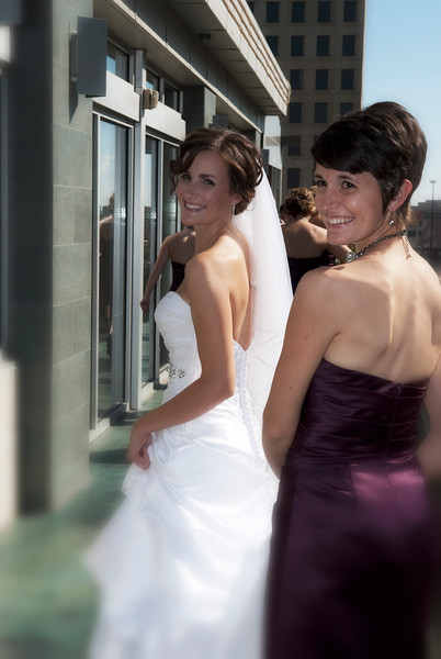 Bride and sister walking along Zen on 7 at Hotel Metro in Milwaukee.