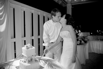 Megan & Shawn cutting their cake in the Weddings & Events Pavillion of theSandbar Restaurant on Anna Maria Island.  http://www.groupersandwich.com/  Music by Chuck Caudill Entertainment www.chuckcaudill.com  Photos by Dara Caudill www.islandphotography.org