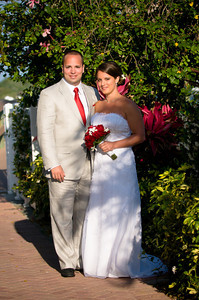 Amber & Anthony's gorgeous wedding under the palm trees of the north pavilion of the Beachhouse restaurant www.groupersandwich.com Photos by Dara Caudill www.islandphotography.org Music by Chuck Caudill www.chuckcaudill.com  Flowers by Don.  Cake by the Cake Zone www.thecakezone.com Hair & makeup by Linda Shepard www.avictorianbride.com Plant rental by Nan Del Palmetto Accommodations by Tortuga Inn www.annamariaislandresorts.net