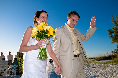 Megan & Shawn after their wedding on the beach in front othe Megan & Shawn after their wedding on the beach in front of the Sandbar Restaurant on Anna Maria Island.  http://www.groupersandwich.com/  Music by Chuck Caudill Entertainment www.chuckcaudill.com  Photos by Dara Caudill www.islandphotography.org