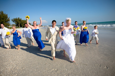 "Michelle & Alex say ""I do"" on the beautiful beach of the Sandbar restaurant. www.groupersandwich.com  Photos by Dara Caudill www.islandphotography.org  Music by Chuck Caudill www.chuckcaudill.com  Flowers by Sarasota Flower Girls www.sarasotaflowergirls.com  Cake by Matt & Dom www.madpastrycafe.com  Alice Foote of Heavenly Vows officiated www.heavenlyvows.com  Accommodations by the Tortuga Inn www.tortugainn.com or www.annamariaislandresorts.net"