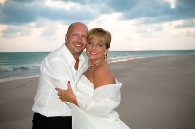 After getting ready at their condo at the Marbella on Anna Maria Island  www.lacostacondo.com ,Kelly & Chris had a beautiful wedding at the Sandbar Restaurant.  www.GrouperSandwich.com  Photos by Dara Caudill www.IslandPhotography.org  Music by Chuck Caudill www.ChuckCaudill.com  Reverend Charlie Shook officiated.  www.ReverendCharlie.com