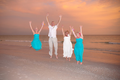 Angela & Les and their daughters from the UK celebrate their marriage at the Sandbar Restaurant on Anna Maria Island during an unbelievable sunset!  www.groupersandwich.com  Photos by Dara Caudill www.islandphotography.org  Video by ChrisAnn Esformes www.silvervideollc.com Officiating was Patti McKee, banquet manager of the Sandbar.