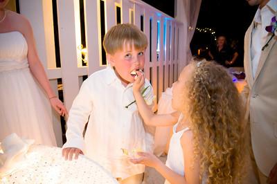 "Michelle & Alex say ""I do"" on the beautiful beach of the Sandbar restaurant. www.groupersandwich.com  Photos by Dara Caudill www.islandphotography.org  Music by Chuck Caudill www.chuckcaudill.com  Flowers by Sarasota Flower Girls www.sarasotaflowergirls.com  Cake by Matt & Dom www.madpastrycafe.com  Alice Foote of Heavenly Vows officiated www.heavenlyvows.com  Accommodations by the Tortuga Inn www.tortugainn.com or www.annamariaislandresorts.net"