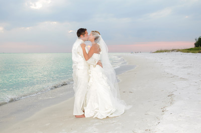 Lindsay & Justin's incredible wedding on Anna Maria Island.  Photos by Dara Caudill www.islandphotography.org  Music by Chuck Caudill www.chuckcaudill.com  Reverend Charlie Shook officiated www.reverendcharlie.com  Flowers by Silvia's Flower Corner www.annamariaflorist.com  Video by Starfruit Productions www.starfruitproductions.com  AJ Latteri of The Loft coordinated & catered.  www.theloft5.com