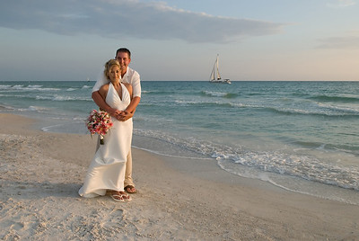 Erin & Steve on the beach for sunset in front of the Beachhouse on Anna Maria Island.