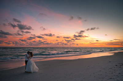 Katie & Brian's beach wedding complete with a beautiful sunset at the Sandbar Restaurant on Anna Maria Island.  www.groupersandwich.com Photos by Dara Caudill www.islandphotography.org Music by Chuck Caudill www.chuckcaudill.com  Officiated by Reverend Charlie Shook www.reverendcharlie.com  Flowers by Birgit at Island Florist www.island-florist.com