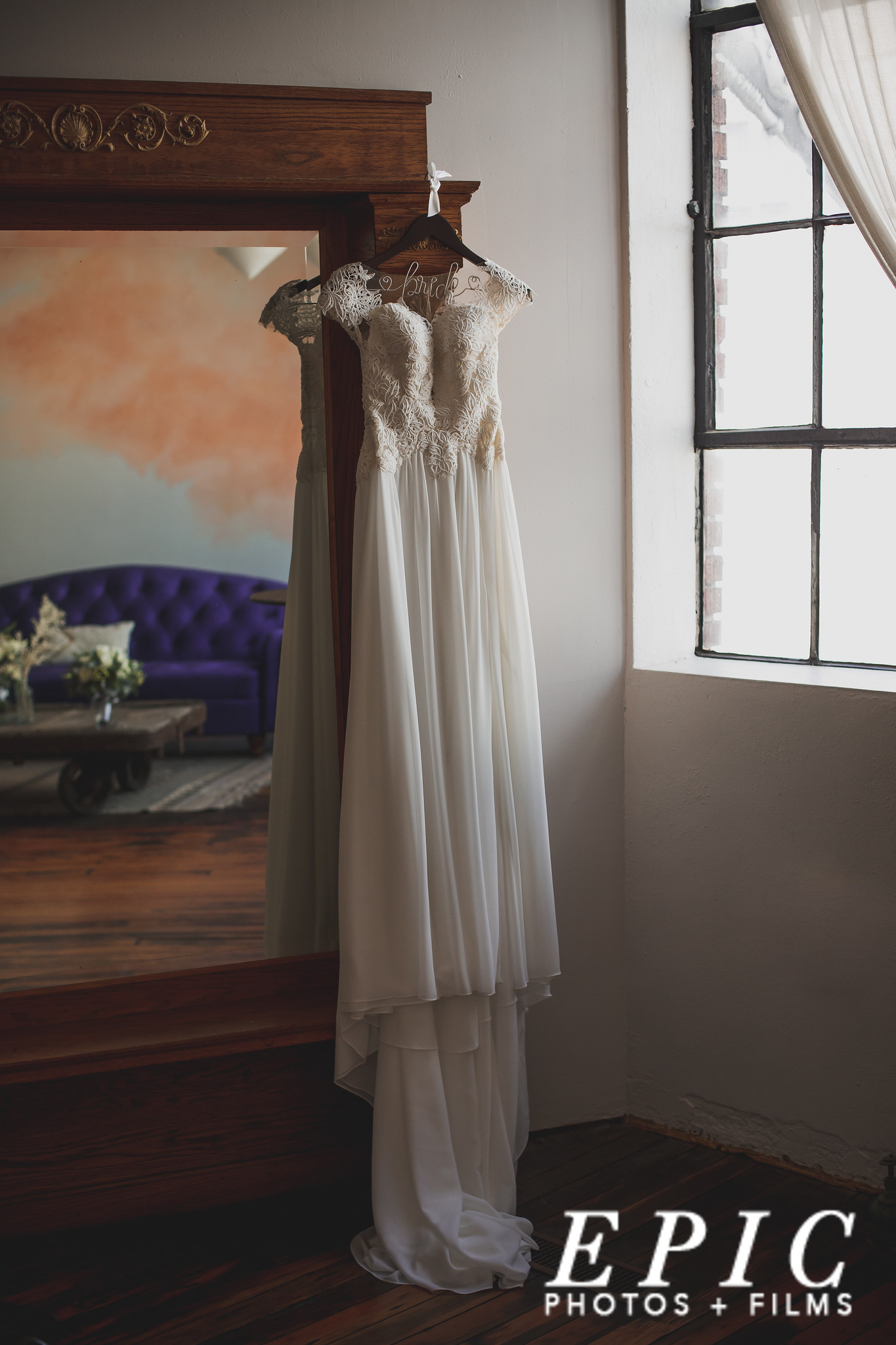 Wedding dress hanging on mirror at Foundation Event Space