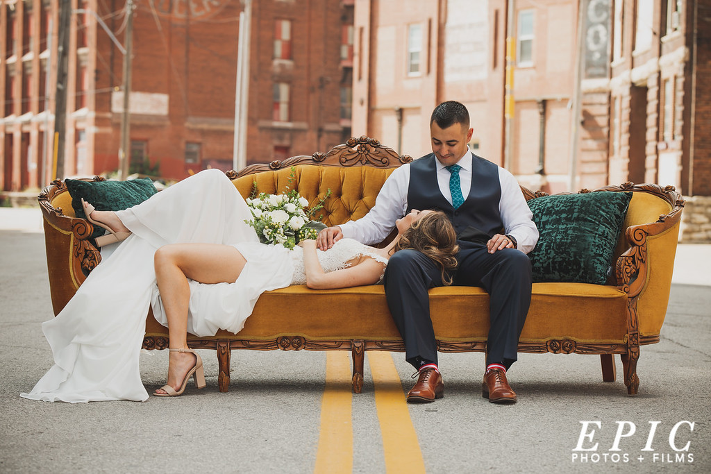 Bride and groom portrait on a couch in the street in West Bottoms, Kansas City
