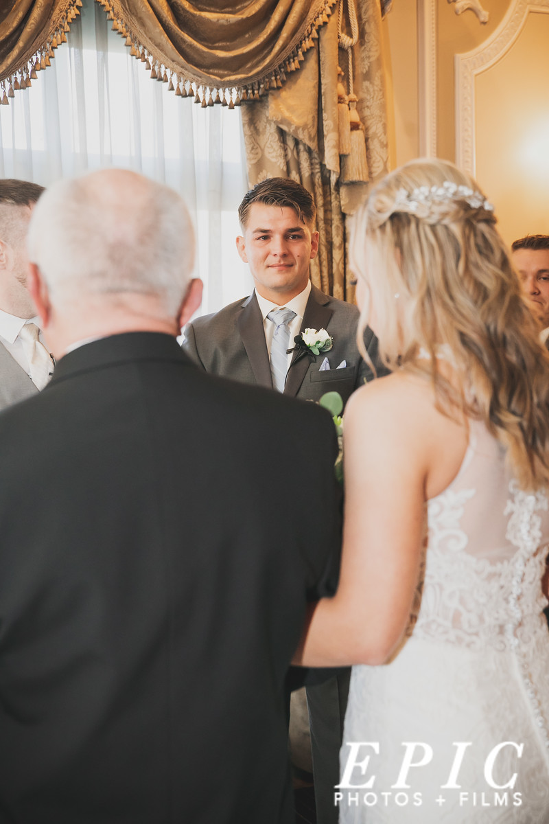 Groom's reaction to seeing his bride for the first time before their wedding at Loose Mansion