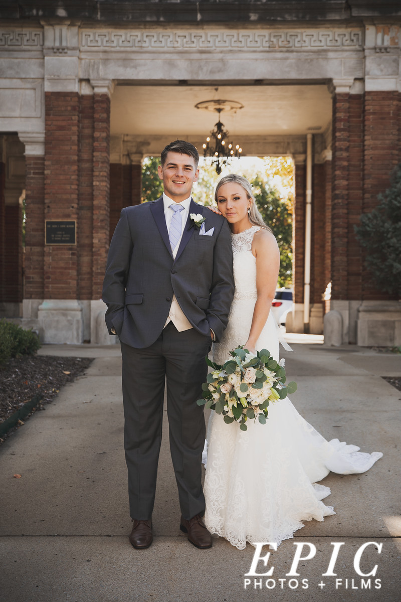 Bride and groom posing during couple's portraits at Loose Mansion