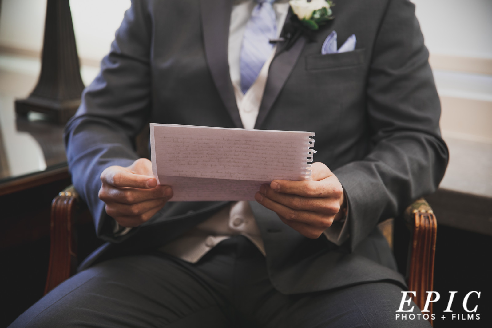 Groom reading letting in groom suite at Loose Mansion