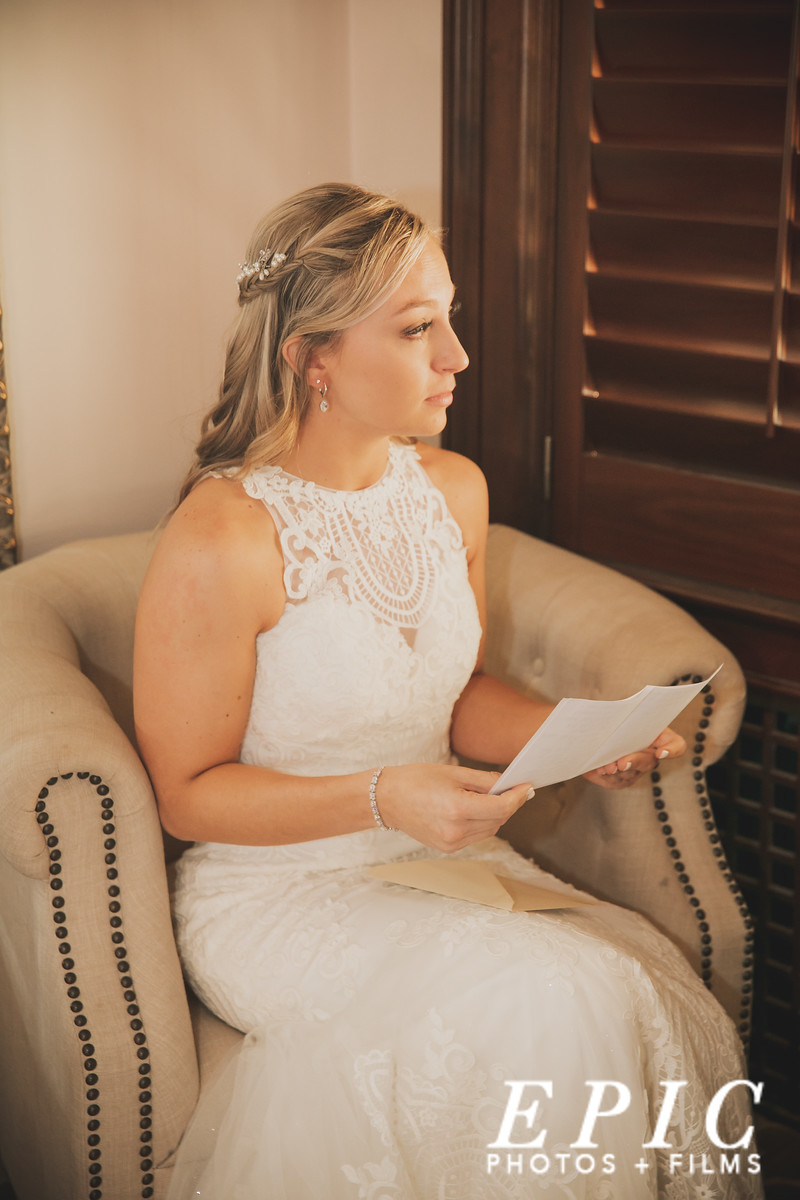 Bride reading letting in bridal suite at Loose Mansion