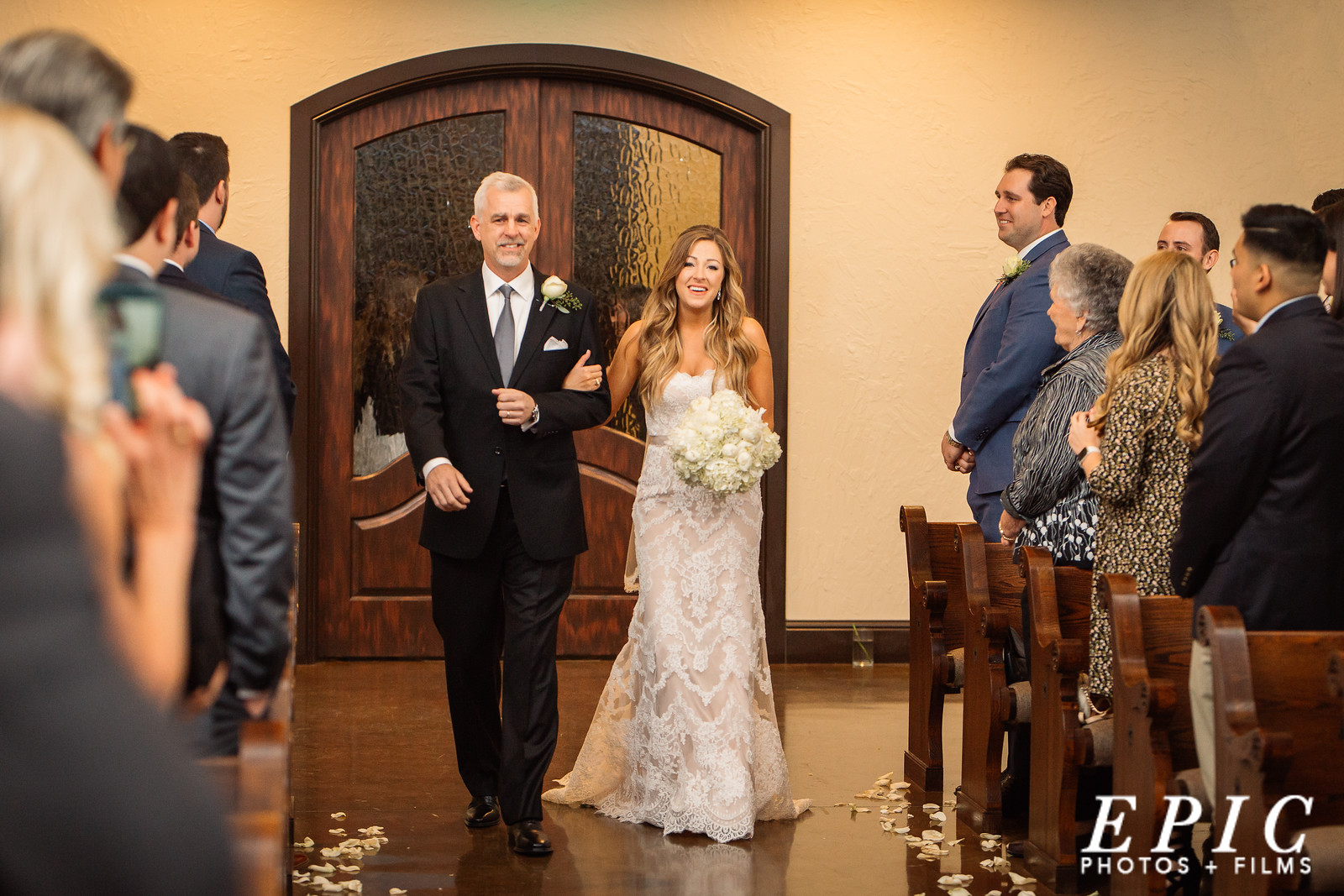 bride being walked down the aisle by her father at the Chapel at Ana Villa