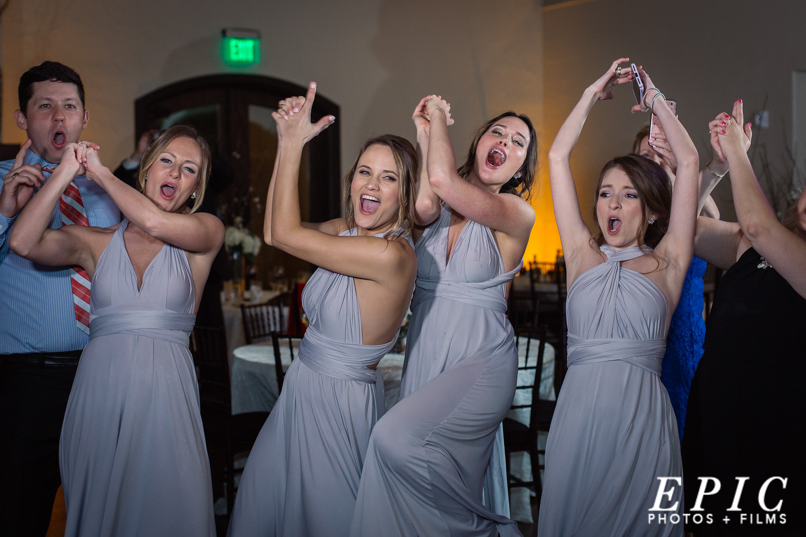 four bridesmaids dancing on the dancefloor in the Main Ballroom of the Chapel at Ana Villa