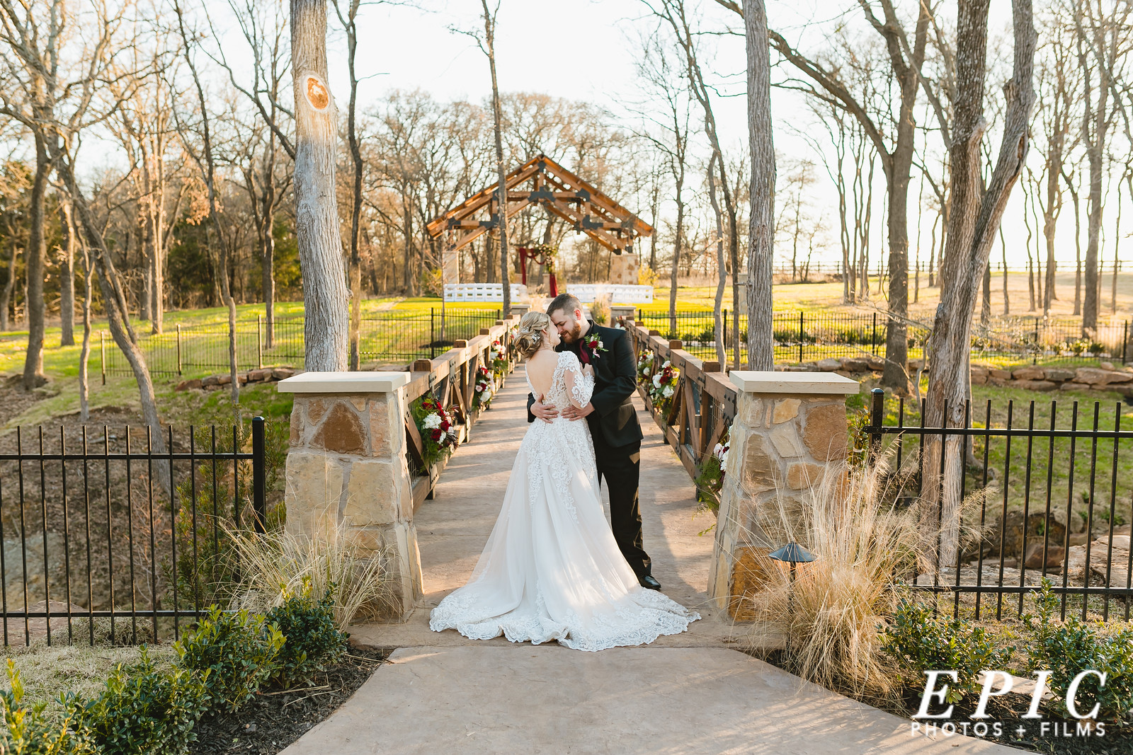 Hailee and Andrew standing chest to chest on the bridge that goes between The Springs main building and the ceremony location