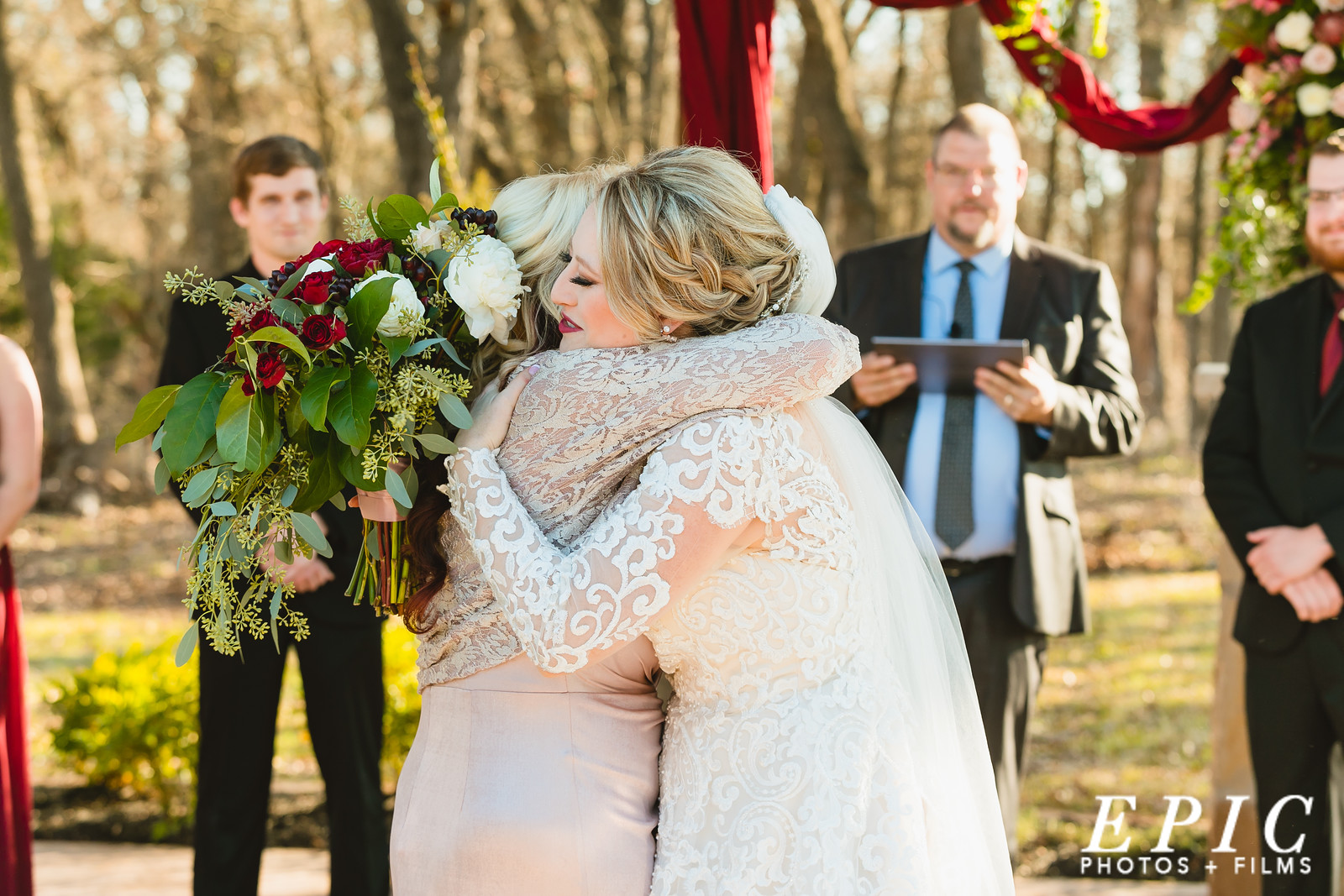Hailee hugging her mother after being walked down the aisle during her wedding ceremony