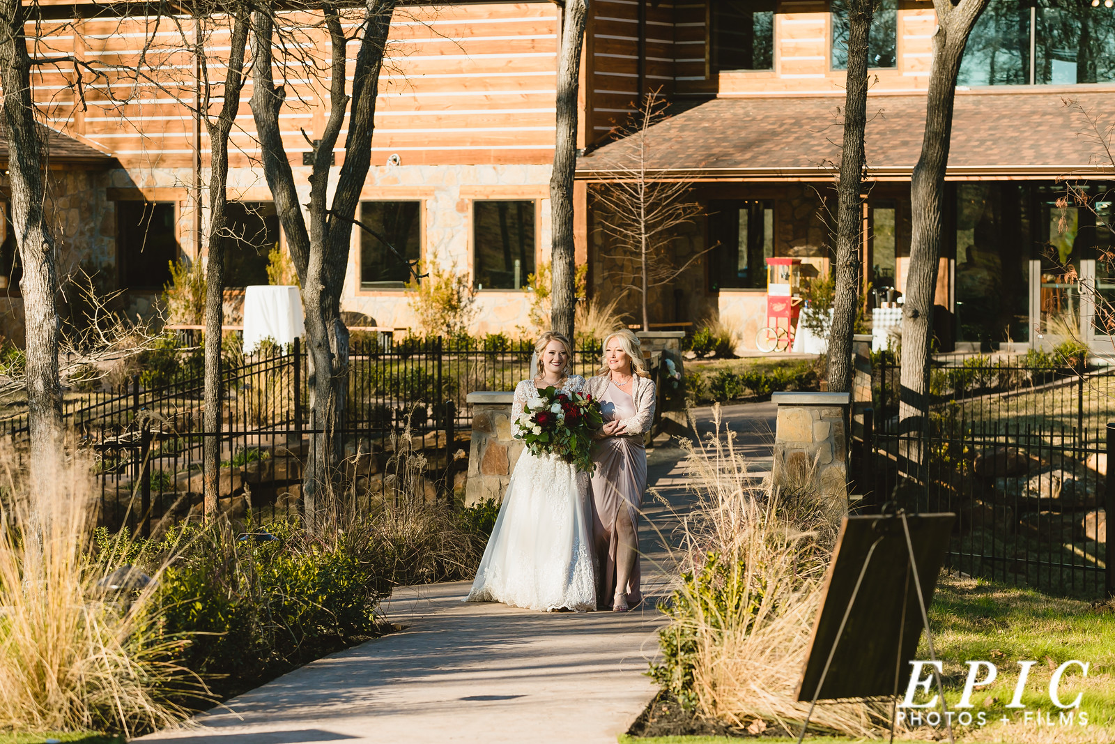 Hailee being walked down the aisle by her mother at The Springs Alvarado