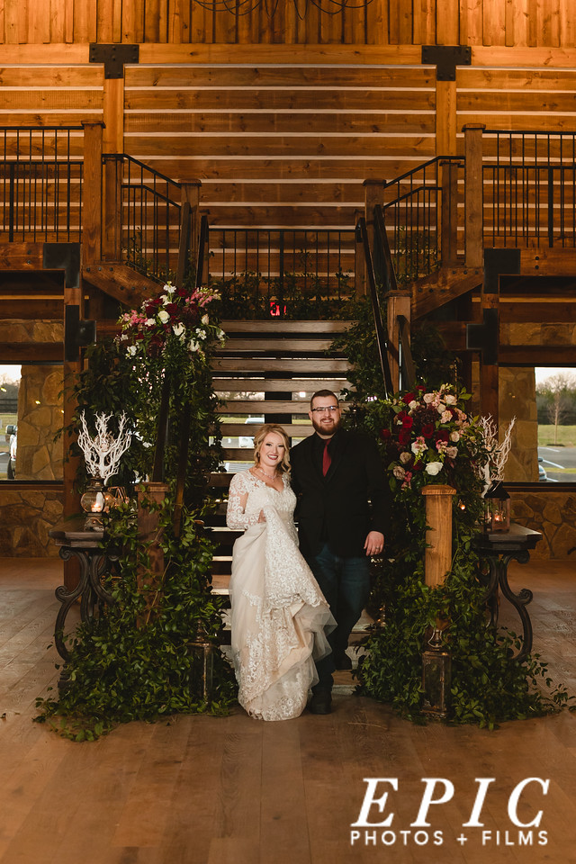 Hailee and Andrew walking down the grand stair case at The Springs Alvarado for the grand introduction of their wedding