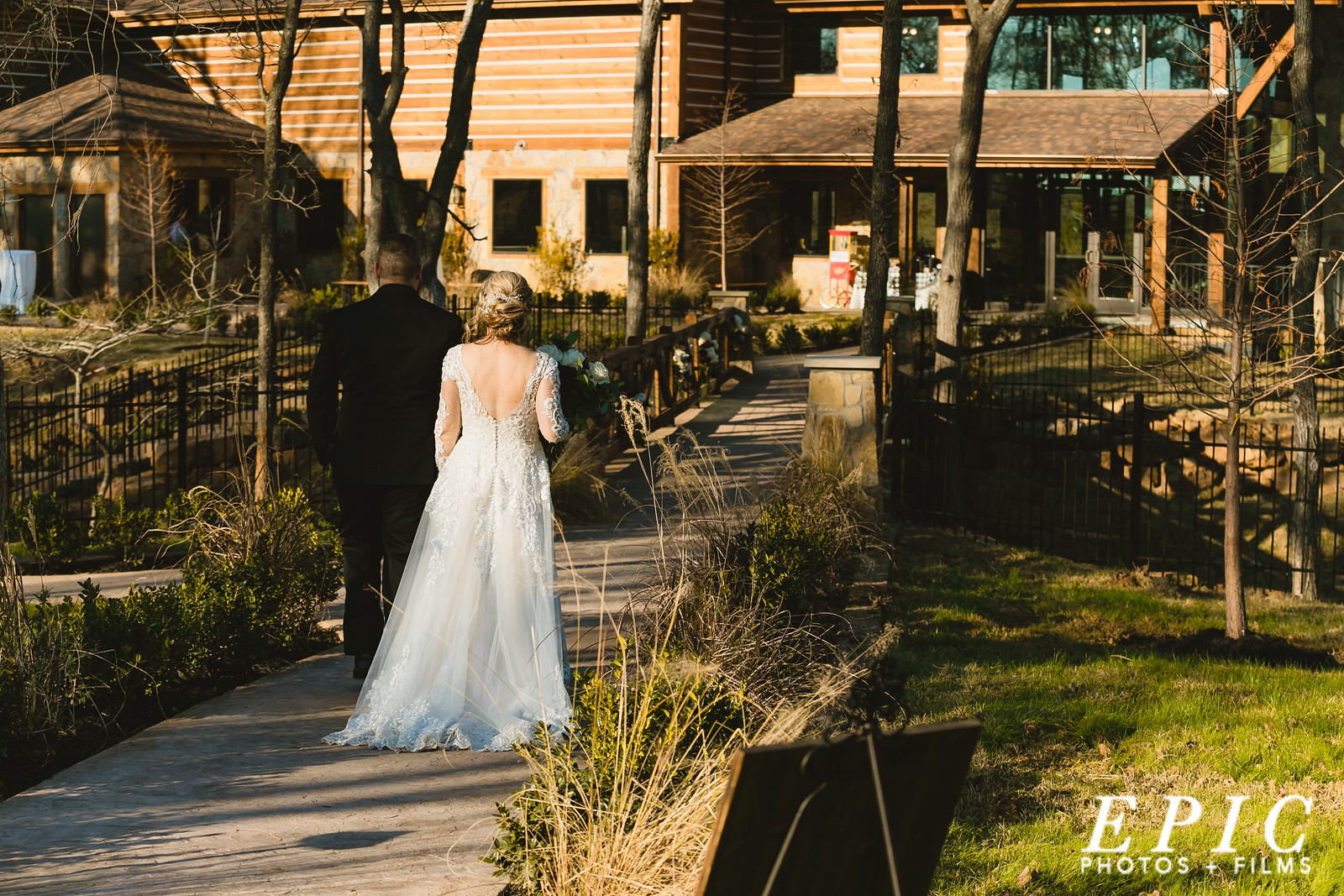 Hailee and Andrew walk away from their ceremony after towards The Springs Alvarado