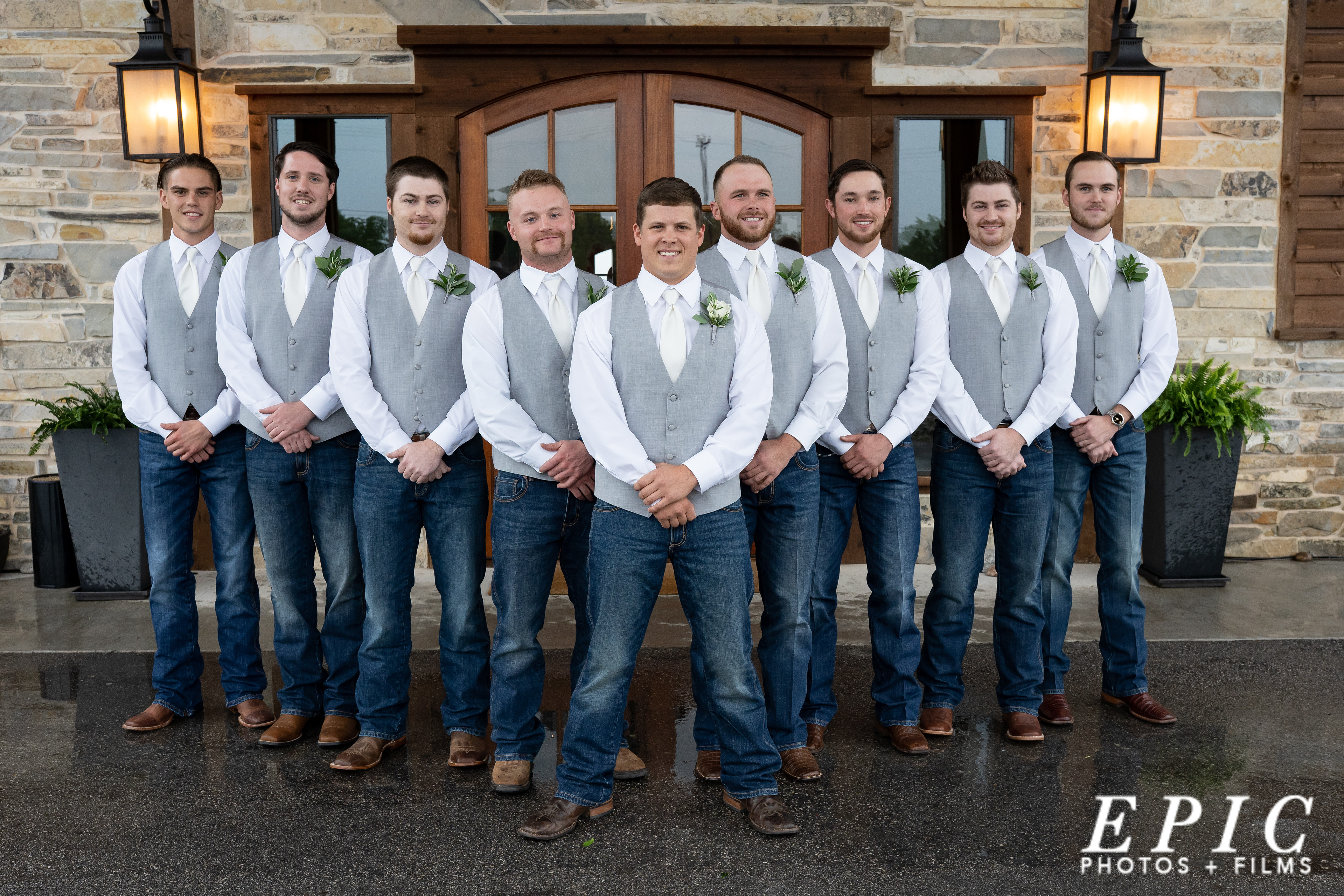 groom and groomsmen standing in front of Stone Crest
