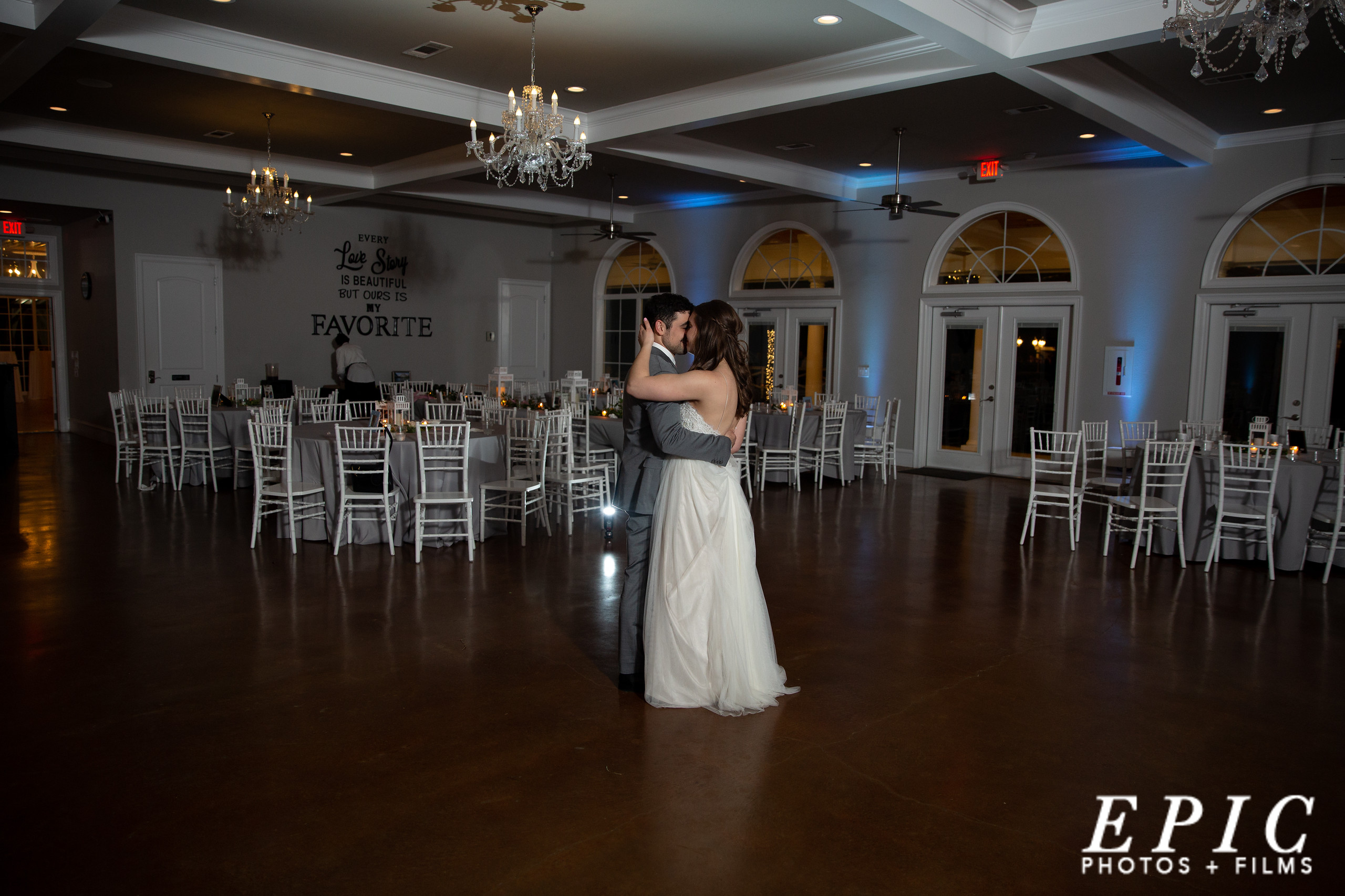 newlywed couple sharing a private last dance on the dancefloor at Willow Creek after all the guests have gone