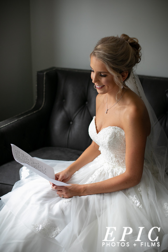 Bride reads letter in the bridal suite at dream point ranch