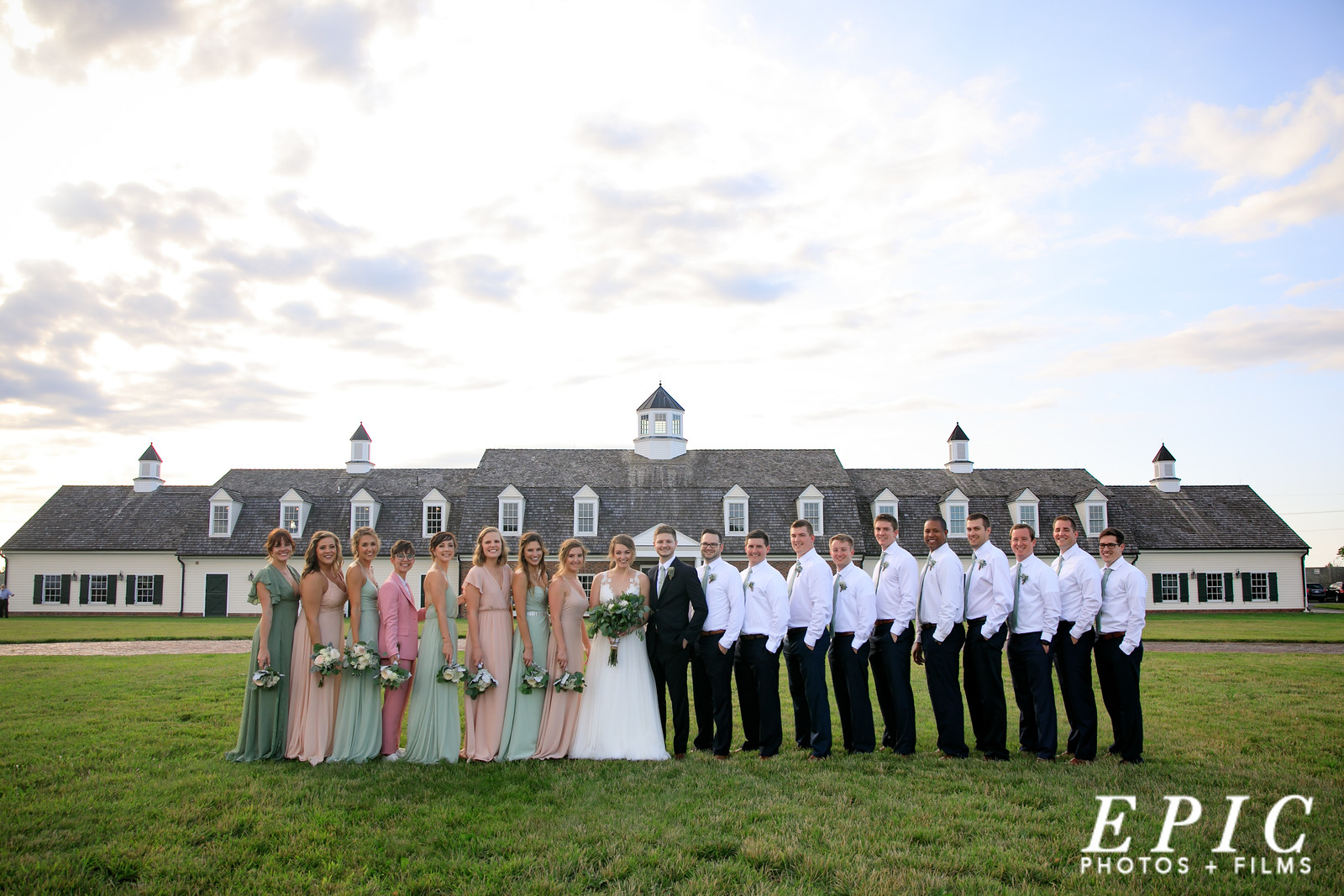 Wedding Day Bridesmaids and Groomsmen group shot in front of Mildale Farm