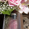 DSC04140j  wedding rings bouquet reflection