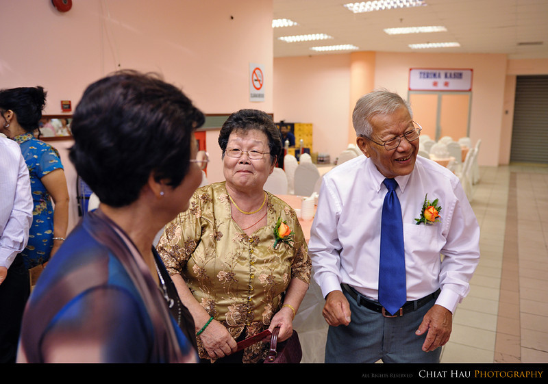 I think granddad and grandma is happy catching up with the relatives also