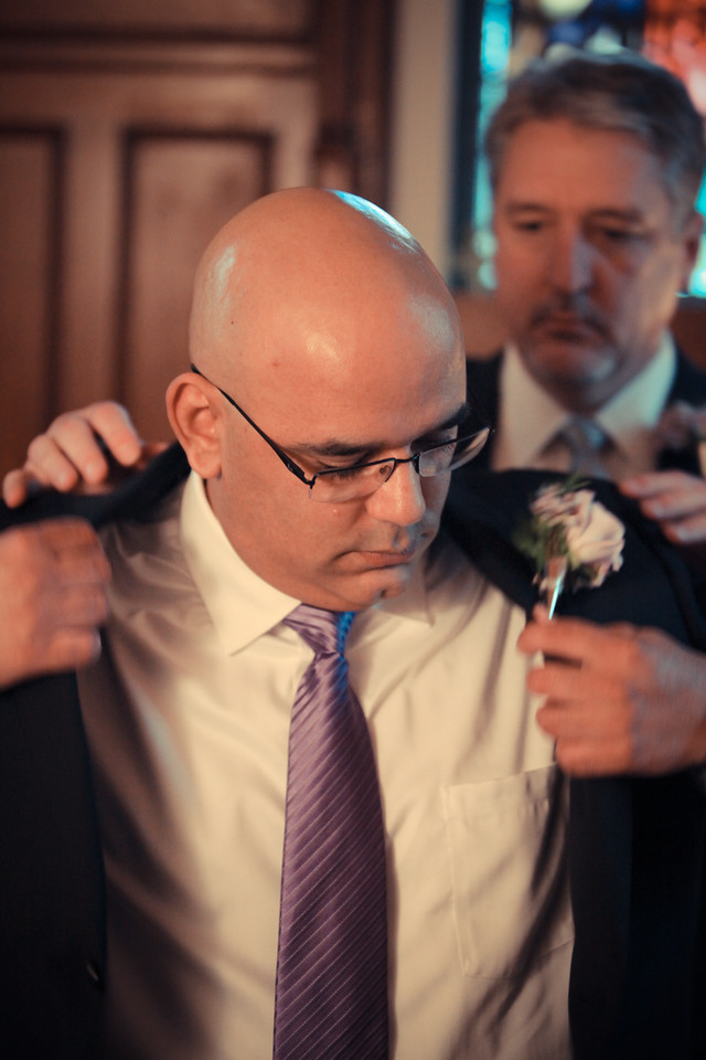 A groom gets ready before his wedding in Wilmington, NC.   Bryce Lafoon Photography