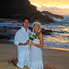 young mixed newlywed couple at sunrise on Eternity Beach, Hawaii