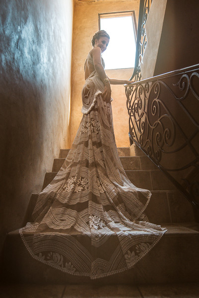 Stunning bride and long wedding dress in vintage hallwayat Villa Del Paraiso, Rosarito, Mexico.