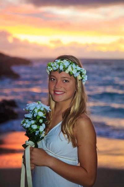 newlywed bride by the ocean at Eternity Beach  in Hawaii