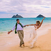 newly wed couple on the beach at Lanikai, Hawaii
