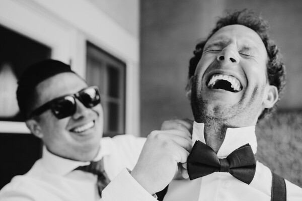 Groomsmen laughing and having fun before the ceremony at Carmel Valley.
