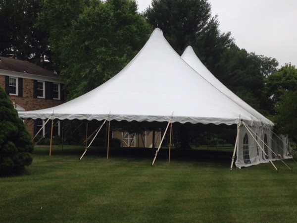 Tent goes up in Stu and Caryl's yard