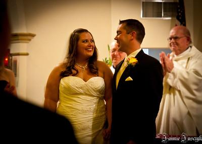 Everyone congratulating the happy couple.