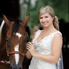 Ashton is a true Southern bride. We loved this picture with one of the horses at The Stables at Russell Crossroads. Photo by Daniel Taylor Photography