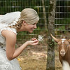 Adorable bride Ashton with one of the fainting goats at The Stables at Russell Crossroads at Lake Martin. Photo by Daniel Taylor Photography.