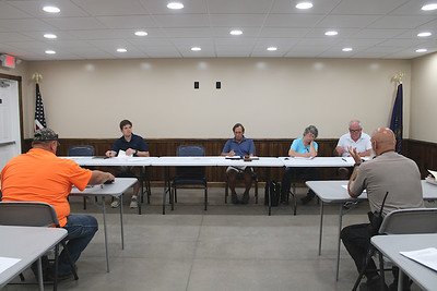 JOHN E. USALIS/STAFF PHOTOThe Ringtown Borough Council holds its first monthly meeting in its new municipal building a short distance from its former office. The building is basically completed with a few finishing touches to be done. Seated at the main table are. from left, Councilman Ian Murray, President Leonard Kamarousky Jr., borough Secretary/Treasurer Angel Mays, and Vice President Thomas Murray. To the left is borough foreman Scott Schuetrum. Mayor Philip Beaver at the right. Also attending were borough solicitor Robert E. Matta and Alfred Benesch and Company project manager Jacqueline Peleschak.